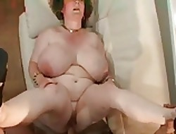 Granny surrounding beamy tits.belly & glasses